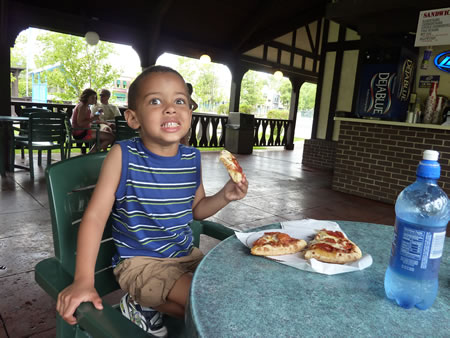 Eating pizza at Adventureland