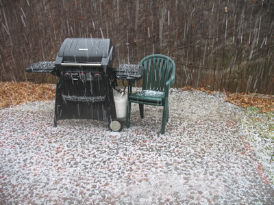 Our brick patio covered in hail